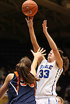 02 January 2012: Duke's Haley Peters (33) shoots over Virginia's Chelsea Shine (50). The Duke University Blue Devils defeated the University of Virginia Cavaliers 77-66 at Cameron Indoor Stadium in Durham, North Carolina in an NCAA Division I Women's basketball game.