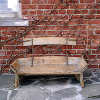 The bench situated on the terrace of a house in upstate New York is actually the restored buckboard seat from a 19th century horse-drawn buggy