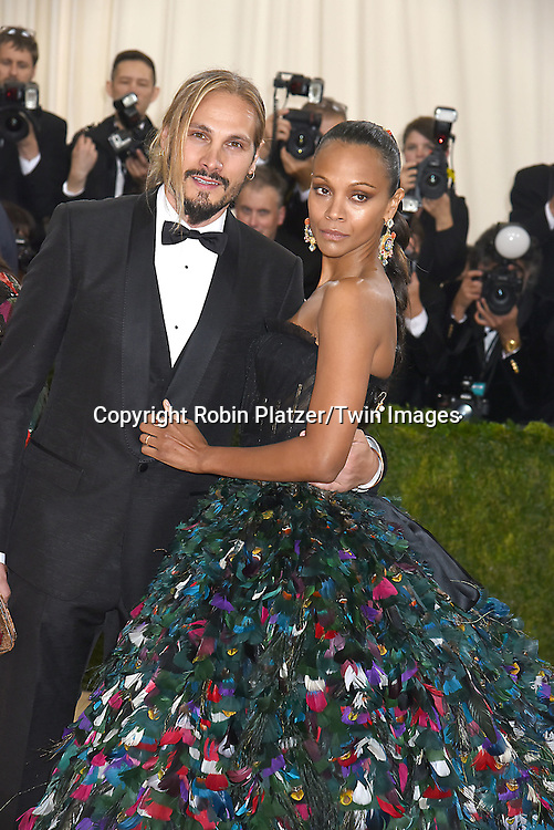 Zoe Saldana and husband Marco Perego Saldana attend the Metropolitan Museum of Art Costume Institute Benefit Gala on May 2, 2016 in New York, New York, USA. The show is Manus x Machina: Fashion in an Age of Technology. <br /> <br /> photo by Robin Platzer/Twin Images<br />  <br /> phone number 212-935-0770