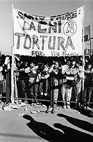 Relatives of 'disappeared' political prisoners accuse the CNI (Centro Nacional de Informacion) secret police of torture at a rally during Pope John Paul II visit in 1987. The banner reads: 'Holy Father: The CNI torture'.