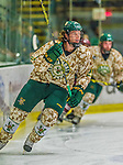25 November 2014: University of Vermont Catamount Defenseman Nick Luukko, a Senior from West Chester, PA, in action against the University of Massachusetts Minutemen at Gutterson Fieldhouse in Burlington, Vermont. The Cats defeated the Minutemen 3-1 to sweep the 2-game, home-and-away Hockey East Series. The 12th ranked Catamounts wore their camouflage uniforms for the evening to honor the US military. Mandatory Credit: Ed Wolfstein Photo *** RAW (NEF) Image File Available ***