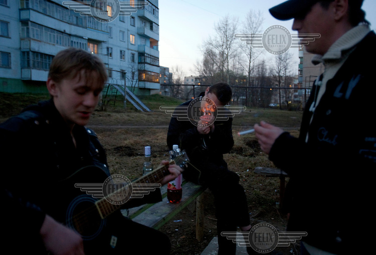 Youngsters smoke and drink vodka in the town of Ivanovo.