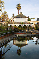 Detail of Gardens, Real Alcazar, Seville, Spain, pictured on December 26, 2006, in the afternoon. The Real Alacazar was commissioned by Pedro I of Castile in 1364 to be built in the Mudejar style by Moorish craftsmen. The palace, built on the site of an earlier Moorish palace, is a stunning example of the style and a UNESCO World Heritage site. The gardens are a mixture of French, Moorish and Renaissance style. Here a pavilion is reflected in a pool. Picture by Manuel Cohen.
