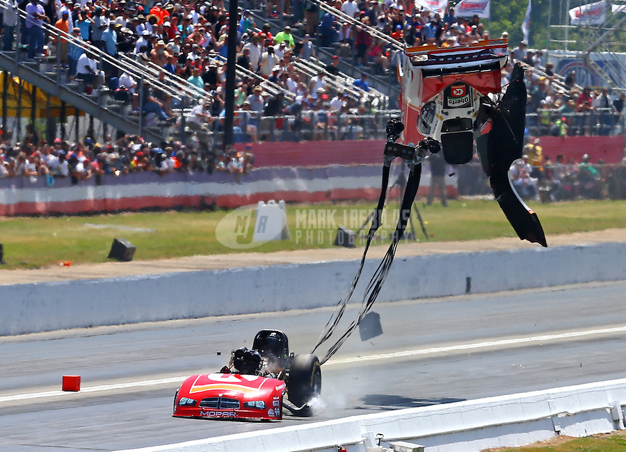 May 15, 2016; Commerce, GA, USA; NHRA funny car driver John Hale explodes the carbon fiber body off his car during the Southern Nationals at Atlanta Dragway. Hale was uninjured. Mandatory Credit: Mark J. Rebilas-USA TODAY Sports