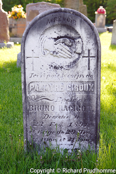 Old tombstone in cemetery in Montebello, quebec