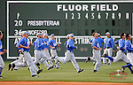 Members of the Presbyterian Blue Hose run sprints in left field before a game on Wednesday, March 19, 2014, at Fluor Field at the West End in Greenville, South Carolina. (Tom Priddy/Four Seam Images)