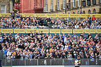 Supporters in the crowd celebrate a penalty to Bath Rugby. West Country Challenge Cup match, between Bath Rugby and Gloucester Rugby on September 26, 2015 at the Recreation Ground in Bath, England. Photo by: Patrick Khachfe / Onside Images