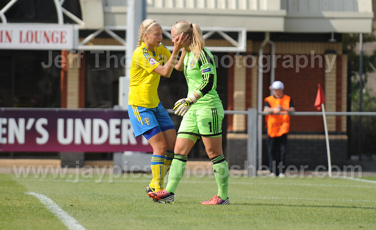 Louise Hogrell of Sweden is consoled by one of her teams players at letting in a 5th Norweigan goal during the UEFA Womens U19 Championships at Stebonheath park Sunday 25th August 2013. All images are the copyright of Jeff Thomas Photography-www.jaypics.photoshelter.com-07837 386244-Any use of images must be authorised by the copyright owner.