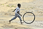 A boy at play in a camp for internally displaced people outside Um Labassa in Sudan's Darfur region.