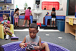 September 14, 2011. Raleigh, NC. . Erwin Echeverria-Torres cuts up straws in the kiddie pool.. Project Enlightenment, a public pre-kindergarten program for at risk children, has been threatened with closure due to state wide budget cuts..