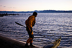 Harry King pulls  kayaks out of Lake Tahoe at Kings Beach, Calif., January 19, 2011.
