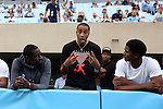 12 September 2015: UNC basketball players watch the game. Brice Johnson (center) with Theo Pinson (left), and Kennedy Meeks (behind). The University of North Carolina Tar Heels hosted the North Carolina A&T State University Aggies at Kenan Memorial Stadium in Chapel Hill, North Carolina in a 2015 NCAA Division I College Football game.