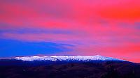 "Mauna Kea Sunset: Sunset over a snow-covered Mauna Kea, taken from Pa'auilo Mauka, Big Island of Hawai'i. Shot on 4x5"" transparency film, available only as a fine art print."