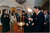 United States President Ronald Reagan lights candles during a visit to the Danilov Monastery in Moscow, USSR on Monday, May 30, 1988..Mandatory Credit: Bill Fitz-Patrick - White House via CNP