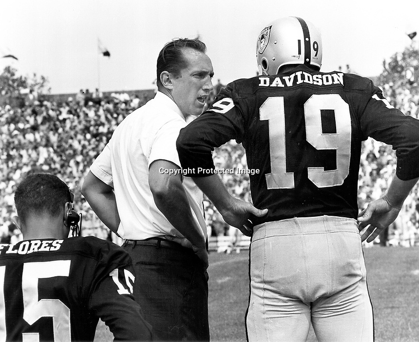 Oakland Raider coach Al Davis on the sideline with QB's Tom Flores and Cotten Davidson.( 1964 photo by .Ron Riesterer)
