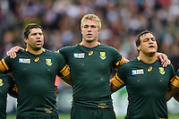 Willem Alberts, Pieter-Steph du Toit and Coenie Oosthuizen of South Africa sing their national anthem. Rugby World Cup Pool B match between South Africa and the USA on October 7, 2015 at The Stadium, Queen Elizabeth Olympic Park in London, England. Photo by: Patrick Khachfe / Onside Images