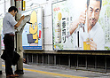 Tokyo, Japan - A Japanese man holds his bag between his legs. Morning commuters typically spend over one hour on the train going to work. Trains are usually so packed that train platform staff have to push commuters to fit in the train so that the doors can close shut. (Photo by Yumeto Yamazaki/AFLO)