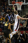 Gonzaga's Domamtas Sabonis (11) goes up for two points against Iowa's Adam Woodbury (34)  and Dom Uhl (25) during the 2015 NCAA Division I Men's Basketball Championship's March 22, 2015 at the Key Arena in Seattle, Washington. #2 Gonzaga beat #7 Iowa 87-68 to advance to the Sweet 16.   ©2015. Jim Bryant Photo. ALL RIGHTS RESERVED.