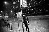 Wroclaw 01.2010 Poland<br /> Drunk transsexual Marina Till waiting for tram.<br /> Marina Till, a transsexual, has had numerous medical examinations and treatments, such as a very intense hormonal therapy, at times seriously weakening her organism. For a long time she has been dreaming  about a sex change surgery that she can not afford. She does not accept herself and her body. Frequent suicide attempts and alcohol abuse, are means of escape from the body she lives in. A body that does not belong to her.<br /> Photo: Adam Lach / Napo Images<br /> <br /> Pijany transseksualista Marina Till czeka na tramwaj.<br /> Transseksualista Marina Till przeszla juz setki kuracji hormonalnych i badan psychoterapeutycznych, ktore w znaczny sposob wycienczyly jej organizm. Od wielu lat marzy o zmianie plci lecz najzwyczajniej nie stac ja na zbyt kosztowna operacje. Nie akceptuje siebie, nie akceptuje swojego ciala. Czeste proby samobojcze i znaczne ilosci alkoholu sa dla niej sposobem na ucieczke, przede wszystkim od swiadomosci ze cialo w ktorym zyje nie nalezy do niej.<br /> Fot: Adam Lach / Napo Images