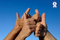 Group of hands, thumbs up, on blue sky (Licence this image exclusively with Getty: http://www.gettyimages.com/detail/103544606 )