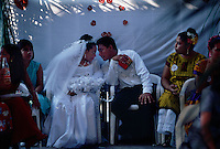 The bride and groom share a moment at their wedding party.  Weekends are full of celebrations complete with traditional food and dancing in the street. Mexico's narrowest point is the Isthmus of Tehuantepec--flat, country where the Zapotec culture is still strong.  Women take leading role in business and government.  The Isthmus never became part of the Aztec Empire and resistance to the Spanish was strong in the mid-1500s.