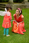 Old Westbury, New York, USA. 28th June 2015. Lori Belilove & The Isadora Duncan Dance Company give dancing lessons to children, throughout the gardens of historic Old Westbury Gardens, a Long Island Gold Coast estate, for its Midsummer Night event. A member of the dance company is shown with young girl wearing fairy wings.