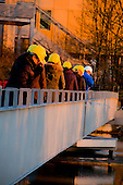 Tour group walking across a treatment pond at Werdhölzli Sewage Treatment Plant, Zürich, Switzerland.