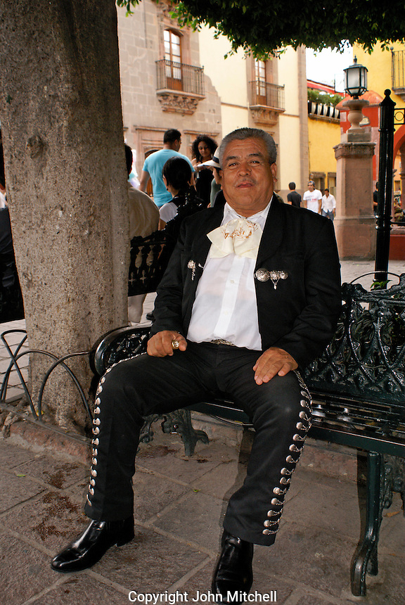Mariachi player relaxing on a bench in San Miguel de Allende, Mexico