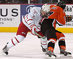 3/4/06 -- Omaha, Ne.University of Nebraska at Omaha's Juha Uotila collides with  Bowling Green's Mike Falk at the Qwest Center Omaha. (Photo by Chris Machian/Prarie Pixel Group).