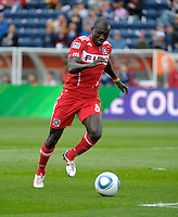 Chicago forward Dominic Oduro (8) shoots and scores Chicago's second goal.  The Chicago Fire defeated the New England Revolution 3-2 at Toyota Park in Bridgeview, IL on Sept. 25, 2011.