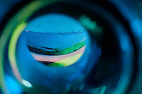 """Beauty at the Bottom: Tequila 20"" - This is a photograph of the famous big blue Cabo Wabo tequila bottle, shot right down inside the mouth of the bottle."