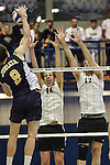 27 APR 2014: Sean Zuvich (14) and Jimmy O'Leary (17) block against Juniata College during the Division III Men's Volleyball Championship held at the Kennedy Sports Center in Huntingdon, PA. Springfield defeated Juniata 3-0 to win the national title.  Mark Selders/NCAA Photos