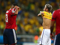 Fredy Guarin of Colombia and Neymar of Brazil swap shirts at half time