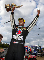 Sep 18, 2016; Concord, NC, USA; NHRA top fuel driver Antron Brown celebrates after winning the Carolina Nationals at zMax Dragway. Mandatory Credit: Mark J. Rebilas-USA TODAY Sports