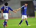 (L-R) Kengo Nakamura, Shinji Kagawa (JPN),.OCTOBER 11, 2011 - Football / Soccer :.Shinji Kagawa of Japan gives a five to his teammate Kengo Nakamura during the 2014 FIFA World Cup Asian Qualifiers Third round Group C match between Japan 8-0 Tajikistan at Nagai Stadium in Osaka, Japan. (Photo by Takahisa Hirano/AFLO)