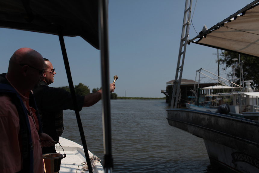 Father John Arnone, Pastor of St Bernard Catholic Church, blesses the fishing boats during an annual ceremony in Delacroix Island on July 31, 2010.