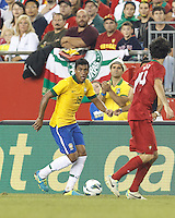 Brazil midfielder Paulinho (18) looks to pass. In an international friendly, Brazil (yellow/blue) defeated Portugal (red), 3-1, at Gillette Stadium on September 10, 2013.