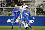 12 December 2014: Providence's Mac Steeves (18) is defended by UCLA's Jordan Vale (NZL) (6) and Chase Gasper (15). The University of California Los Angeles Bruins played the Providence College Friars at WakeMed Stadium in Cary, North Carolina in a 2014 NCAA Division I Men's College Cup semifinal match.