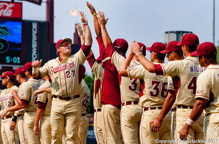 TALLAHASSEE, FL 10-FSU-TAMUBASE11 CH-Florida State's Stuart Tapley, left, gets fired up with his team prior to NCAA Super Regional action against Texas A&M Sunday at Dick Howser Stadium in Tallahassee. The Seminoles beat the Aggies 23-9 to stay alive in the best of three series...COLIN HACKLEY PHOTO