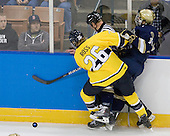 Adam Ross (Merrimack - 26), Mike Voran (Notre Dame - 16) - The University of Notre Dame Fighting Irish defeated the Merrimack College Warriors 4-3 in overtime in their NCAA Northeast Regional Semi-Final on Saturday, March 26, 2011, at Verizon Wireless Arena in Manchester, New Hampshire.
