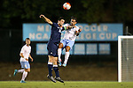 06 October 2015: UNCW's Colin Bonner (23) and North Carolina's Raby George (SWE) (right) challenge for a header. The University of North Carolina Tar Heels hosted the University of North Carolina Wilmington Seahawks at Fetzer Field in Chapel Hill, NC in a 2015 NCAA Division I Men's Soccer match. North Carolina won the game 3-0.
