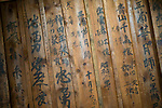 """Photo shows the """"gakuya"""" dressing room area of Korakukan theater, Japan's oldest extant wooden playhouse in Kosaka, Akita Prefecture Japan on 19 Dec. 2012. On the walls is the graffiti -- written by actors -- for which the theater is also famed. Photographer: Robert Gilhooly"""