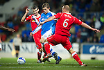 St Johnstone v Ross County...17.11.12      SPL.Murray Davidson gets between Ross Tokely and Stuart Kettlewell.Picture by Graeme Hart..Copyright Perthshire Picture Agency.Tel: 01738 623350  Mobile: 07990 594431
