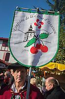 France, Aquitaine, Pyrénées-Atlantiques, Pays Basque,  pendant la fête du piment d'Espelette, défilé des Confrèries dans les rues du village - Confrérie de la Cerise d'Itxassou //  France, Pyrenees Atlantiques, Basque Country, Espelette:   during Espelette pepper festival ,   brotherhoods parade in the village streets,  Itxassou Cherry  brotherhood