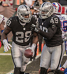 Oakland Raiders fullback Jamize Olawale (49) congratulates running back Latavius Murray (28) on touchdown on Sunday, December 04, 2016, at O.co Coliseum in Oakland, California.  The Raiders defeated the Bills 38-24.