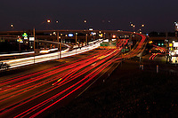 Rush hour on Highway 183 & Interstate 35 (I-35) freeway at night, long exposure, motion blur, elevated view