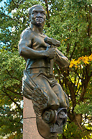 "This statue on Charlotte's Trade and Tryon streets Square is one of four standing on each corner of the intersection. The sculptures were created by artist Raymond Kaskey and are titled ""Transportation,"" ""Future,"" ""Commerce,"" and ""Industry."" This statue, Transportation, is symbolized by a railroad worker holding a hammer in his hand."