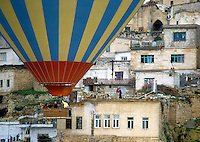 Goreme, Cappadocia, Nevsehir, Turkey. The Village of Ortahisar.  A hot air balloon flight is one of the best ways to explore the fairy chimney landscape of Cappadocia and the Gorme National Park. Photo by Frits Meyst / MeystPhoto.com
