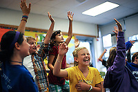 Raya Aberbach (left), Henry Wilson, Lili Lipkin, Ellie Kayser and Audrey Roloff make suggestions with their classmates as T.J. Wheeler (not pictured) sings a funny line from the song they are collaboratively writing during the Blues Corps practice at Grant Elementary School on Tuesday, September 22, 2009.