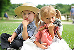 Old Bethpage, New York, USA - July 21, 2012: ROBERT WALKER, 4, of Coram, and JULIAN LYNN ZOLL, 6, of Levittown, wear clothes of American Civil War era while portraying family members of Union soldiers at Camp Scott re-creation, at Old Bethpage Village Restoration, to commemorate 150th Anniversary of American Civil War, on Saturday, July 21, 2012.